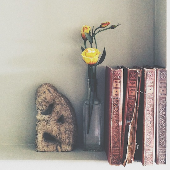 yellow-rose-with-vintage-books-statue